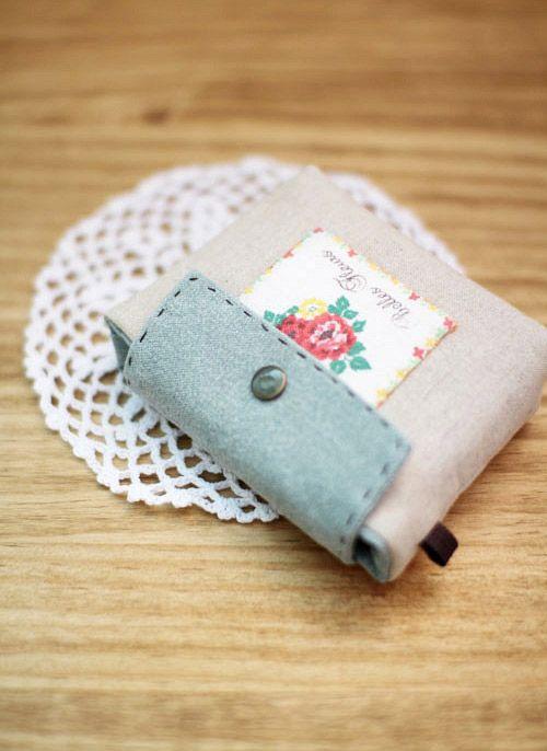 Cucire tessuto un portafoglio biglietto da visita.  Fai da te in immagini.