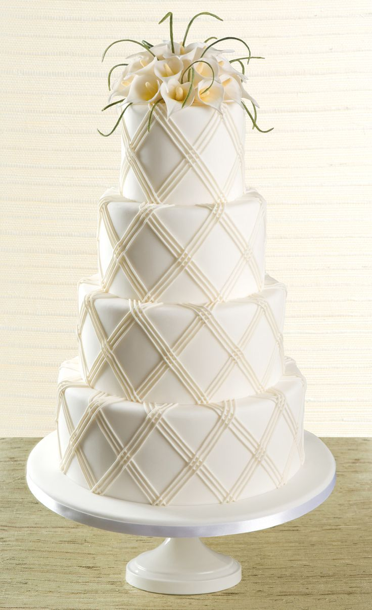 Calla Lily wedding cake...could be done as a single tier cake...I'd use different greenery though