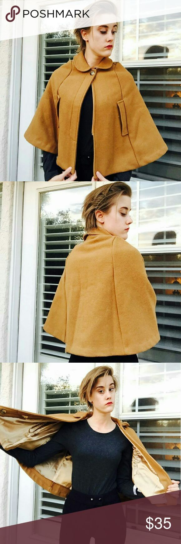 Wool Cape. American Apparel Wool Cape. This is actually a kids size, but I liked it enough to wear it as is! Pair with a long sleeve shirt and cute leggings with combat boots and you're good to go! Rare and discontinued. American Apparel  Jackets & Coats Capes