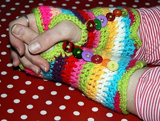 Crochet wrist warmers with mis-matched buttons - idea only.  No pattern.