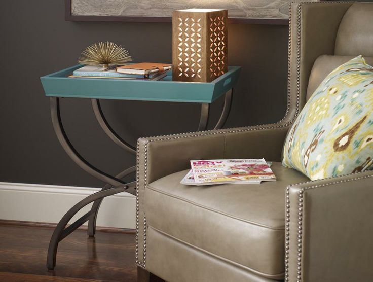 a teal tray table fits into any area of a room offering extra storage space with an updated feel
