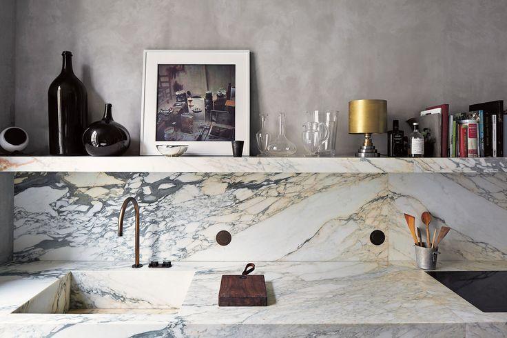 Despite the sleek design, the kitchen gets a lot of use. A photograph by Joseph Dirand's friend François Halard leans on the open shelf. (Photo: Simon Watson)