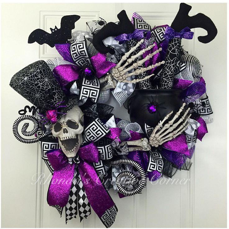 The WOW factor Halloween wreath, Spooky Skeleton Wreath, Skelton Deco Mesh Wreath, Halloween Deco Mesh Wreath, Skeletin Wreath, Witch Legs by RhondasCre8iveCorner on Etsy https://www.etsy.com/listing/477471961/the-wow-factor-halloween-wreath-spooky