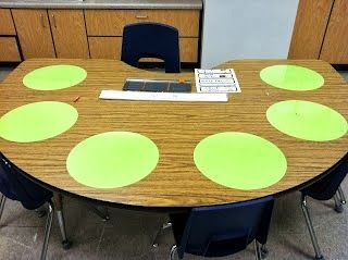 These lovely little circles are vinyl and can be cut out with cricut. Not only do they stick to the table, but they're dry erasable! No more passing out white boards!