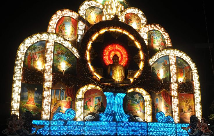 A giant Vesak Day display featuring a seated Buddha during the annual Buddhist festival in Colombo, Sri Lanka.