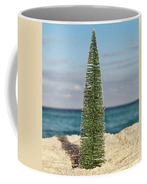 Coffee Mug featuring the photograph Little Christmas Tree by Evgeniya Lystsova. Christmas Tree on sandy tropical beach with blue sea and sky as a background, holiday concept. Christmas is the time of giving and receiving gifts. Coffee Mugs are great choice for a special gift. More options of Art Products (Prints, Home Decor, Lifestyle) you can find in my gallery. #EvgeniyaLystsovaFineArtPhotography #Christmas #Gift #Season #Mugs #HomeDecor