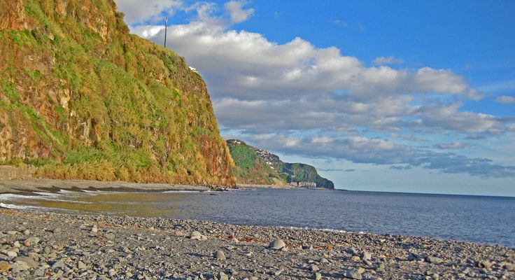 Volcanic cliffs seen from the rocky beach of Ponta do Sol. Madeira, Portugal homes for sale