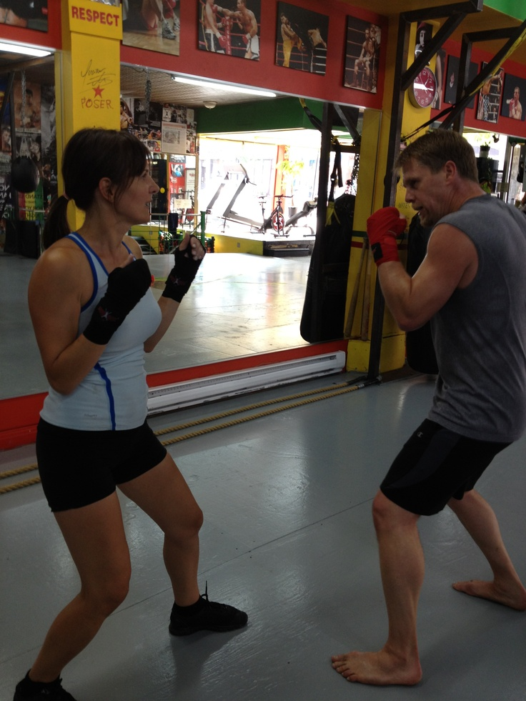 A few of us have joined our in-house boxer - our COO, who's been at it for 20 years. Here, Melissa - our Marketing VP - gets the chance to take on her boss mano a mano!