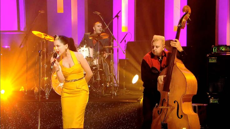 Imelda May - Tainted Love.  As respects the music Imelda performs, she does not have a genre-restricted repertoire; any one song can have elements of more than one genre in it. She does rockabilly -- for which she was warned that she would go nowhere for it --; she does swing/cabaret; jazz, and R'n'B, too. She is a very eclectic performer. Thank you, Lally Pegorini, for putting me on to her music.