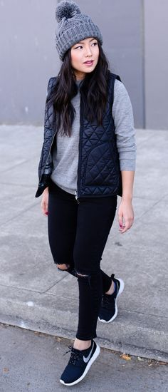 Nikes, vest, gray tee- vegas outfit