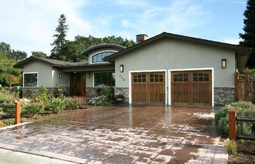 like the garage door and stone and curved roof line