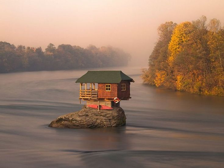 Drina River house, Serbia. The tiny wooden house, built by a group of young boys in 1968 for sunbathing,  is destroyed every time it floods.