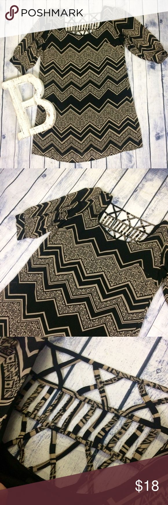 Plus size chevron caged back Black and Tan dress Plus size 1x dress. Sheer fabric fully lined. Chevron with Aztec print inside some of the lines. Black and Tan colors. Like new condition! 3/4 sleeves. Gorgeous caged style back. Make me an offer! 20% off all bundles! boutique Dresses