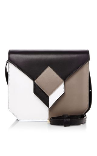 A bold, geometric take on the shoulder bag, this **Pierre Hardy** Prism bag is crafted in block colored calf leather.
