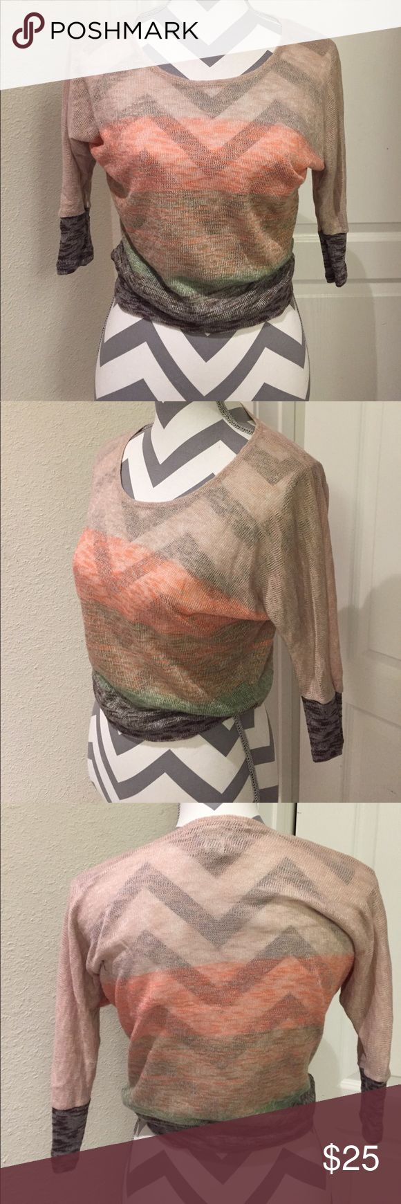 American Rag sheer sweater top A 3/4 sleeve, sheer sweater shirt with vintage tan, orange, green, and brown tones. The shirt is slouchy but gathers at a band at the waist giving a very retro silhouette. Barely worn, great condition. American Rag Tops Tees - Long Sleeve
