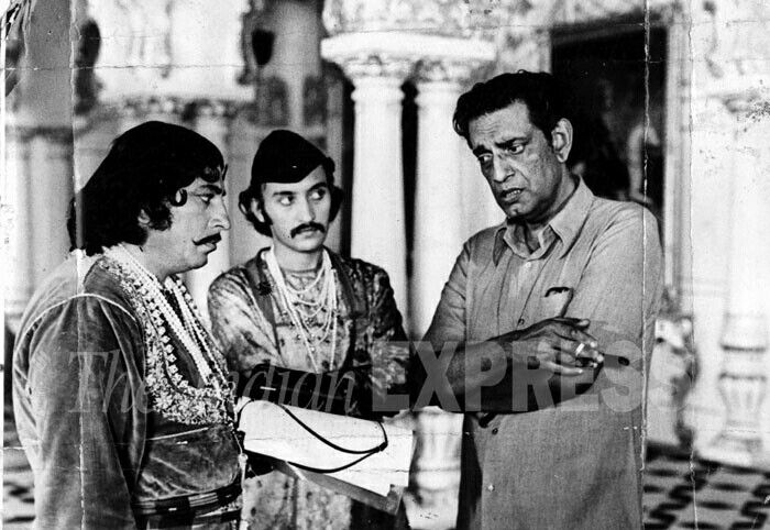 "Satyajit Ray with Amjad Khan and Victor Banerjee during shooting of the movie ""Shatranj ke Khiladi"" in 1970s."