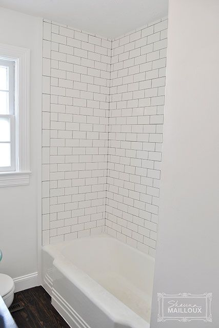 finished edge of subway tile with trim (dark grout - see instructions)