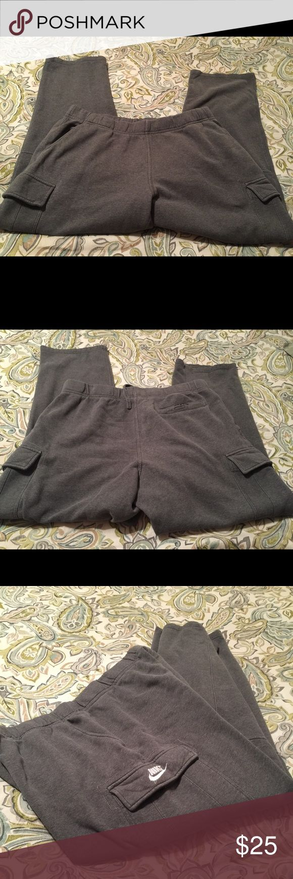 Men's Nike athletic pants size XXL. Men's Nike athletic pants size XXL. This is a great pair of gray cargo type athletic pants. They have pockets and are in great shape. Please view all pictures. Nike Pants Sweatpants & Joggers
