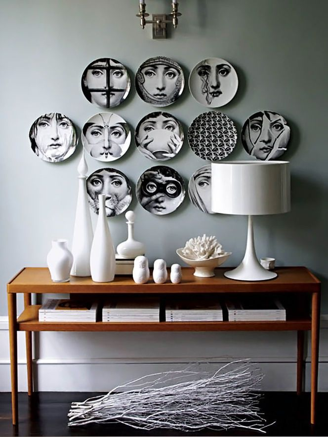 We are obsessed with all thing #Fornasetti right now! Love these vintage plates with the modern Flos lamp! #bespoke #avantgarde