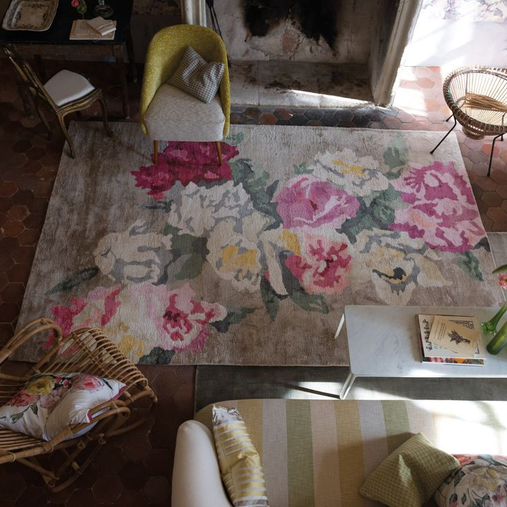 Designers Guild Octavia Rug - A painterly arrangement of roses colouring from fullest claret, to pale grey and deepest jade. This exceptional hand knotted bamboo silk rug offers a deep luxurious pile and firm body with a sense of movement.