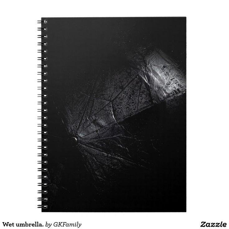 Wet umbrella. spiral notebook
