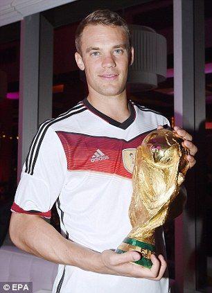Safe hands: Manuel Neuer holds the trophy...