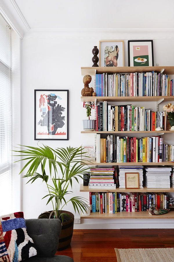 DECORATING IDEAS: the best little apartment. Bookshelf with colorful books and house plant