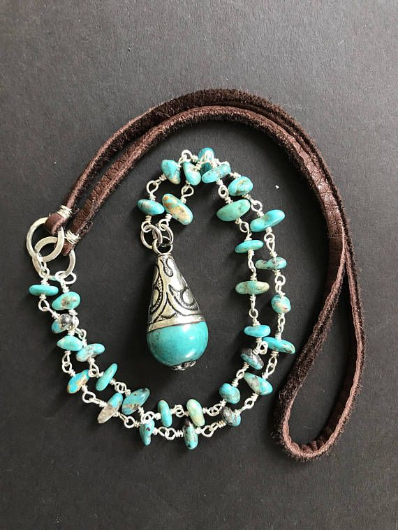 Lovely boho necklace made of real turquoise nuggets, silver and leather. I just love the earthy combination of these three materials together. I made the turquoise and silver bead chain by hand using tiny nuggets of real turquoise from Arizona. The bead chain is about 8 long on each