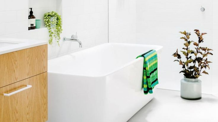 bathroom-dos-and-donts white freestanding bath plant blond wood