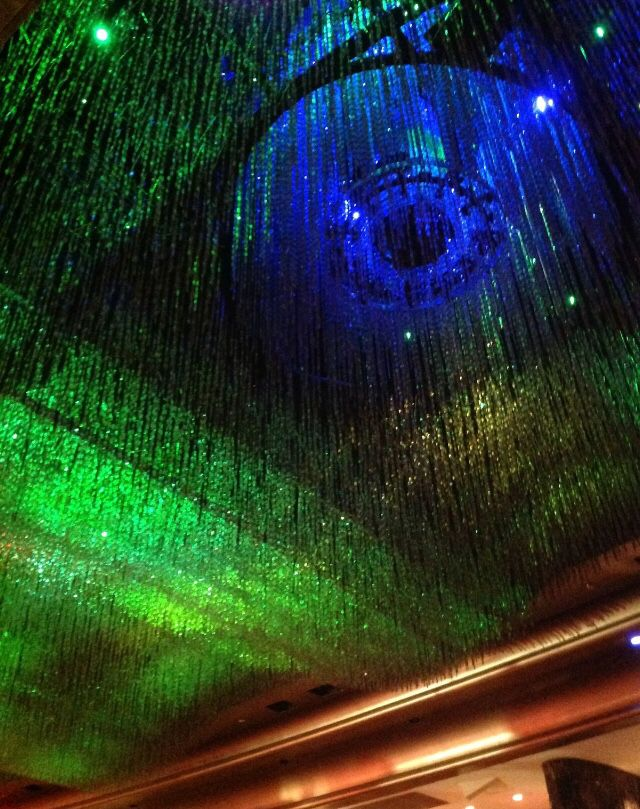 Atrium at Crown Casino.  Different lengths of crystals creates visual interest, depth and texture. This combined with the coloured lighting effects is mesmerising.
