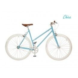 Bicicleta Fixie de piñón fijo o libre según coloques la rueda, de líneas suaves y ligeras, de color azul claro metalizado  y blanco, cuadro de chica o de chico según modelo.