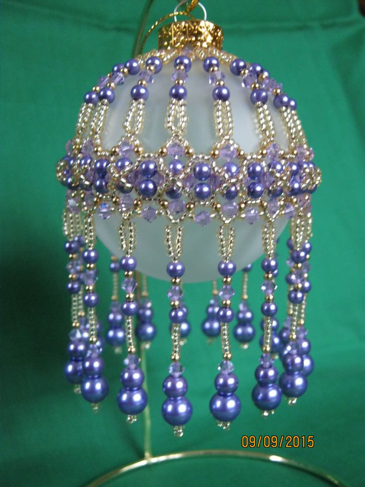 Veiled beauty in purples--This doesn't look like it would be too difficult to make nor too time consuming.