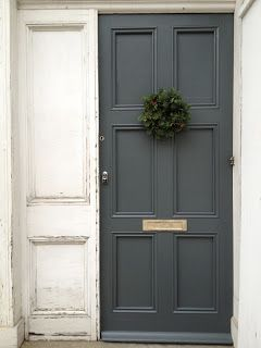 Front door painted with Farrow and Ball's Downpipe shade.