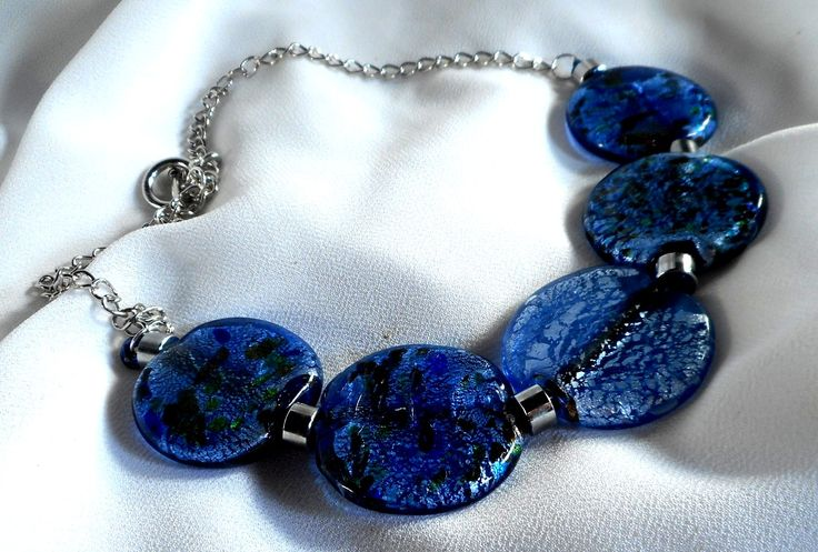 JakDesigns Blue Glass Necklace A necklace made from blue glass and stainless steel. $65