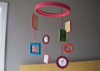 Hanging mobile made from thrift store frames.