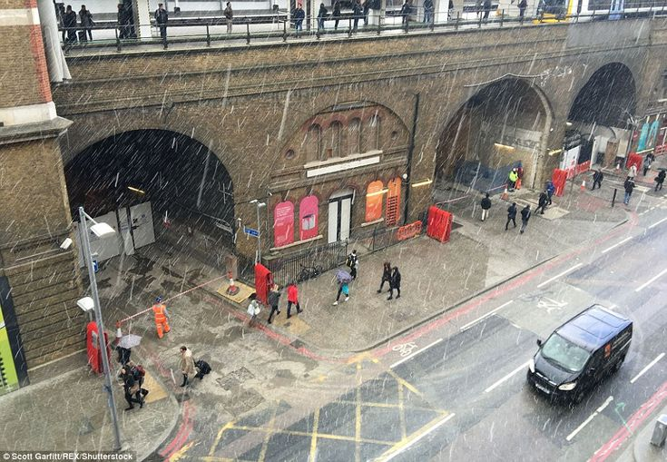 Snow falls in Tooley Street by London Bridge station in central London as Arctic weather sweeps south in the end of April 2016.