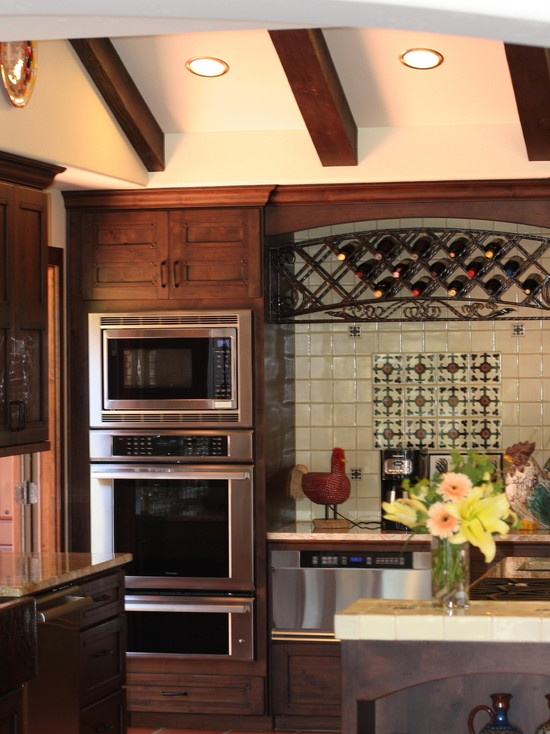 Mediterranean Kitchen Appliances, love the dark cabinets, ovens, and the wine rack, oh the wine rack!