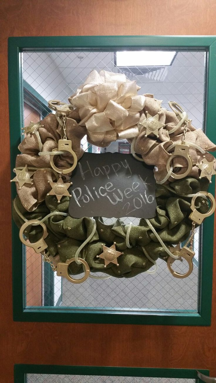 Happy Police Week 2016 Wreath made for the Linn County Sheriff's Office in Cedar Rapids, IA. Burlap gold and olive green wreath with gold sheriff stars and gold handcuffs. #SheriffWreath