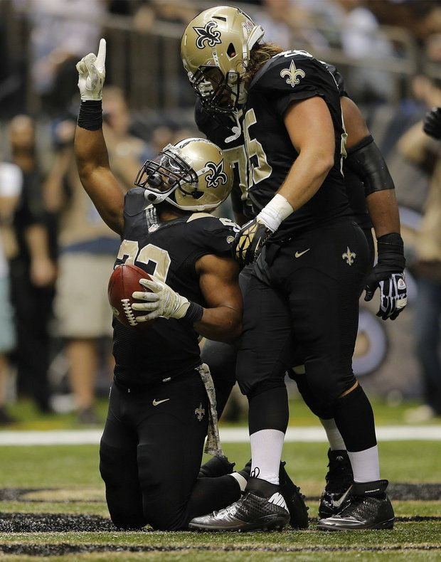 Running back Mark Ingram (22) rushed for 145 yards against the Cowboys. Here, shown on knees with Jed Collins (45) standing behind.  Credit:  (David Grunfeld, NOLA.com | The Times-Picayune)