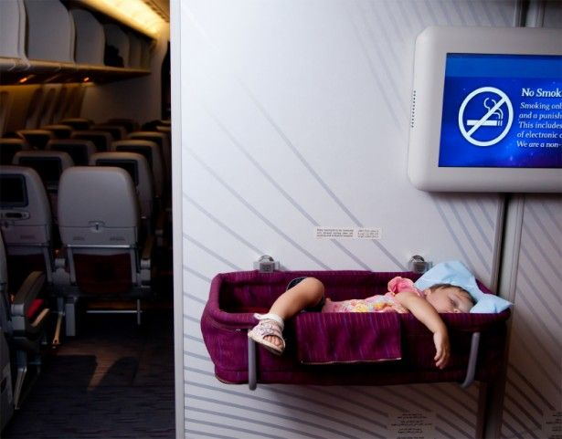 Airplane Sleeping Pods | Small two year old baby girl sleep in a bassinet on a airplane