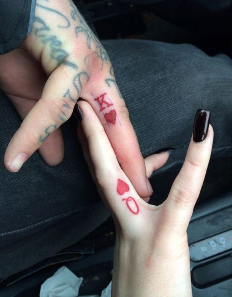 King of Hearts and Queen of Hearts couple tattoo. I would want this on our ring fingers since Shawn can't wear his ring at work.