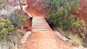 From my trip to Palo Duro State Park in Texas; Wooden Plank Path in Red Desert Stock Photos