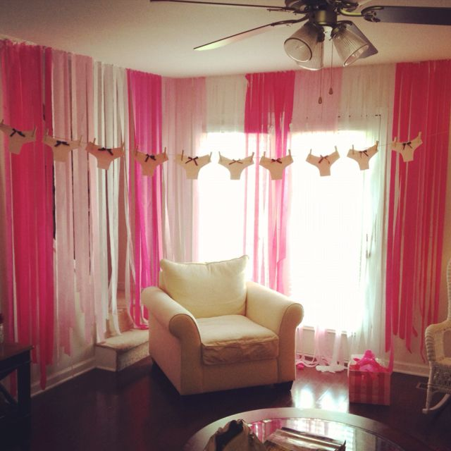 Lingerie party! it wouldnt be curtains but you might be able to do something like this with plastic table cloths as a backtdrop! and the panty garland is cute!