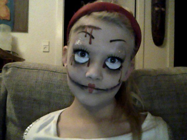 I painted my little sister a creepy doll for Halloween<3