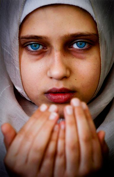 From the series Playing despite war, a Palestenian girl recites Qura'an verses in a mosque at Gaza City.    Eman Mohamed, photographer