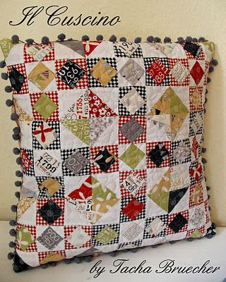 I like the small squares set as diamonds within squares... good use of small scraps.  Don't necessarily love the overall pattern though.