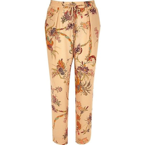 River Island Pink floral print soft tapered pants ($70) ❤ liked on Polyvore featuring pants, pink, tapered pants, women, river island, floral printed pants, peg-leg pants and beige pants