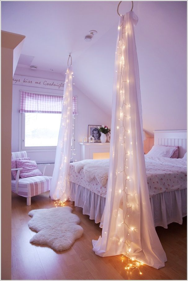 Create atmosphere with a string of lights hidden in shear curtains or fabric. The site has a few other DIY ideas for decorating with lights.