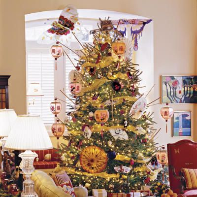 Asian Christmas Tree:     Silk lanterns, supported by bamboo rods, and paper parasols are the main ornaments on this tree. For a small dose of tradition, gauzy gold ribbon and strands of twinkle lights nestle among branches.