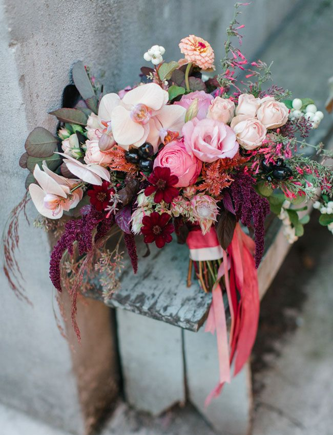 Berry toned fall bouquet with orchids, roses, cosmos + blushing bride protea